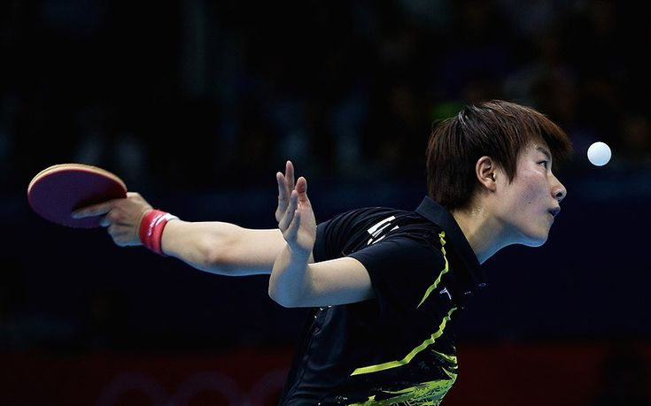 Ning Ding of China completes during the Women's Singles Table Tennis quarter-final match against Ai Fukuhara of Japan - London 2012 Olympics