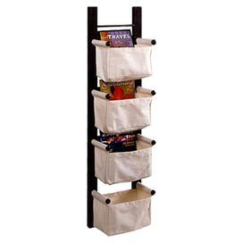 """Stow away your magazines in style with this dark espresso-hued magazine rack, featuring 4 canvas baskets for attractive storage.    Product: Magazine rackConstruction Material: Canvas and woodColor: EspressoFeatures:  Four basketsDimensions: 44"""" H x 12"""" W x 7"""" D"""