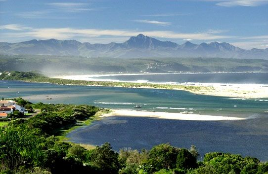My favorite holiday destination in South Africa growing up.. that little spit of sand is where I spent many hours building sand castles.. :) Plettenberg Bay.
