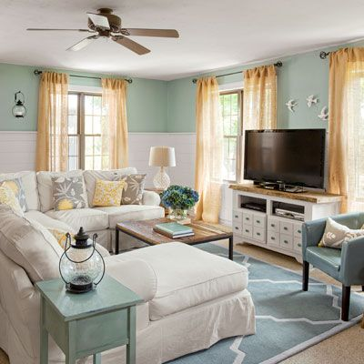 A nice idea for a Family Room- the high curtains and mid wall paint create an intimate feel to the room perfect for snuggling into couches or settling on the floor for games! With my own colors and designs, the general concept is nice! (reader budget remodel living room after)