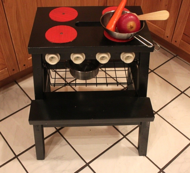 Play kitchen made out of an Ikea step stool - Brilliant! From Grow & Resist