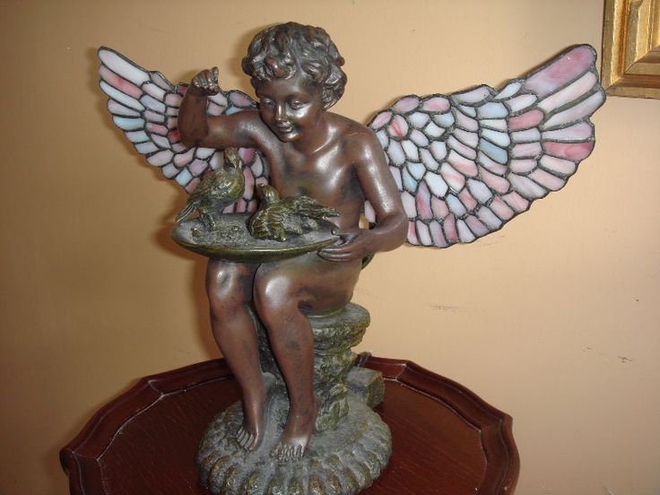 gorgeous victorian reproduction table/ desk lamp feeding birds angel with stained glass wings and lights in the back.perfect condition.