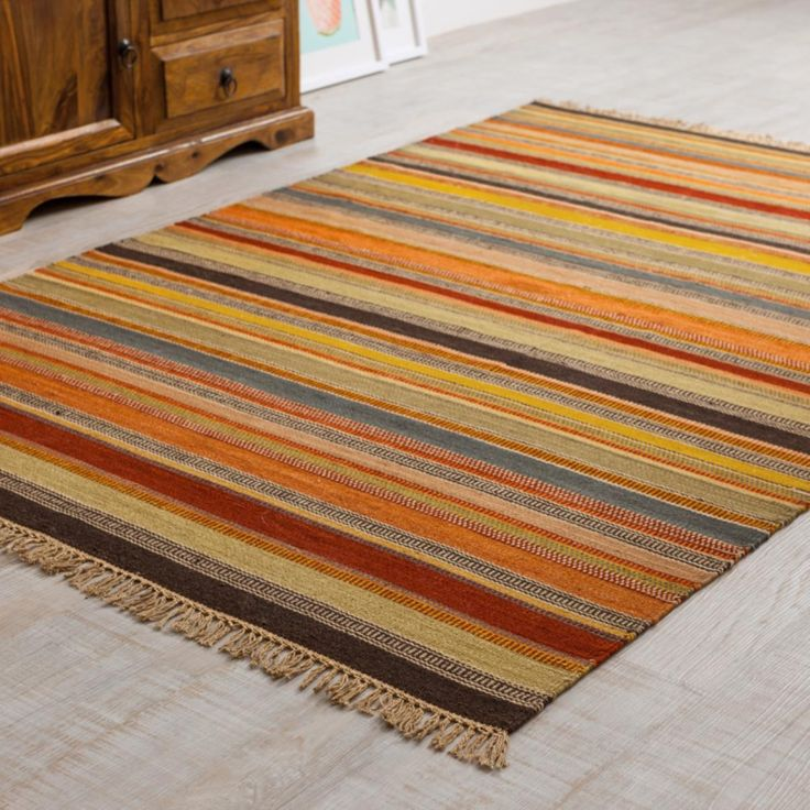 Set off your room with this Ooty Stripe Wool Kilim Rug. In deep rich colours, these are traditionally hand made and incredibly hard wearing.