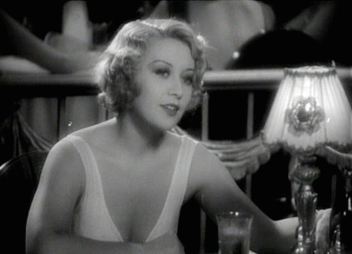 American actress Joan Blondell in a furtrimmed coat and a