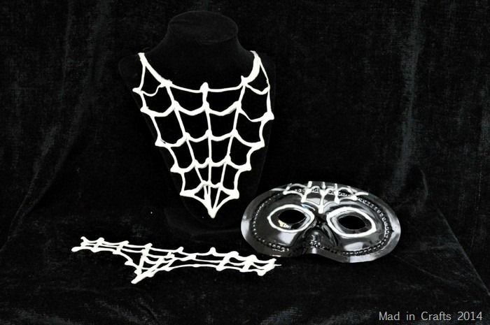 Use glow in the dark puffy paint to make last minute Halloween costume accessories.