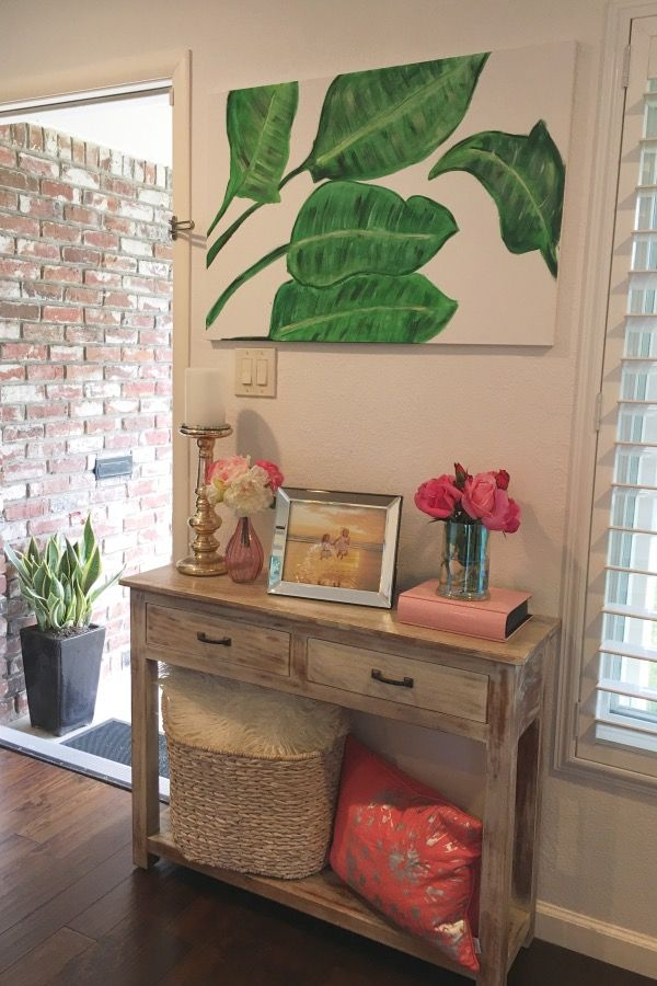 Create a welcoming entry with a small console table accessorized in a theme or color. HomeGoods Sponsored Pin.