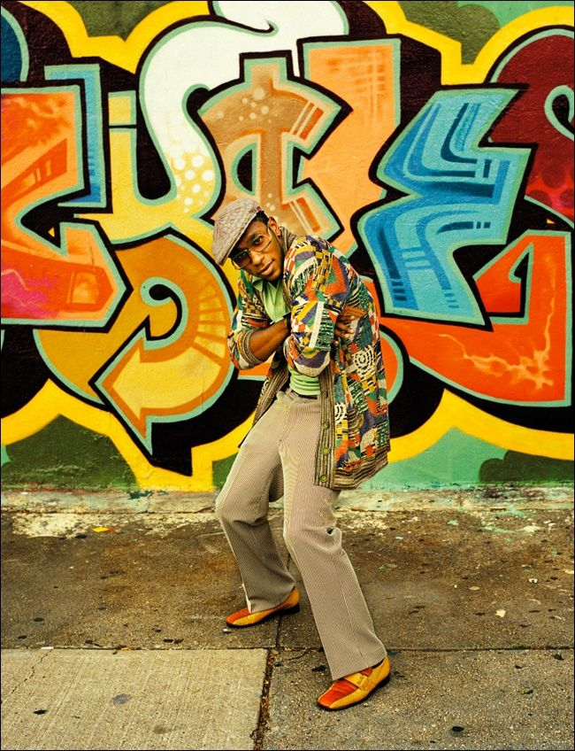 mos def in front of a graffiti piece. so hip hop.