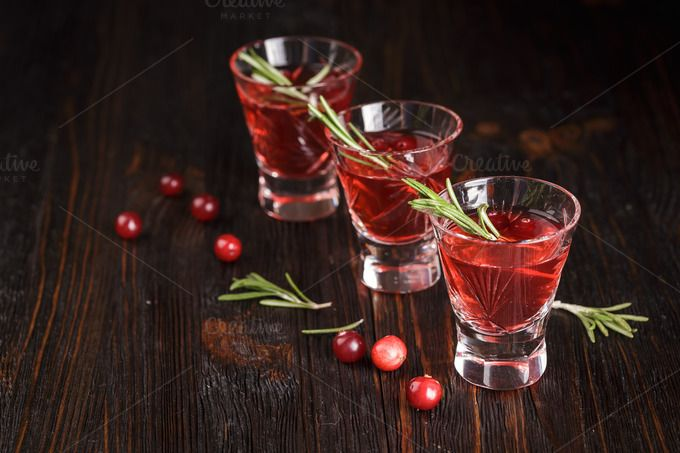 Glasses of fresh cranberry drink. by Irrin0215 on @creativemarket