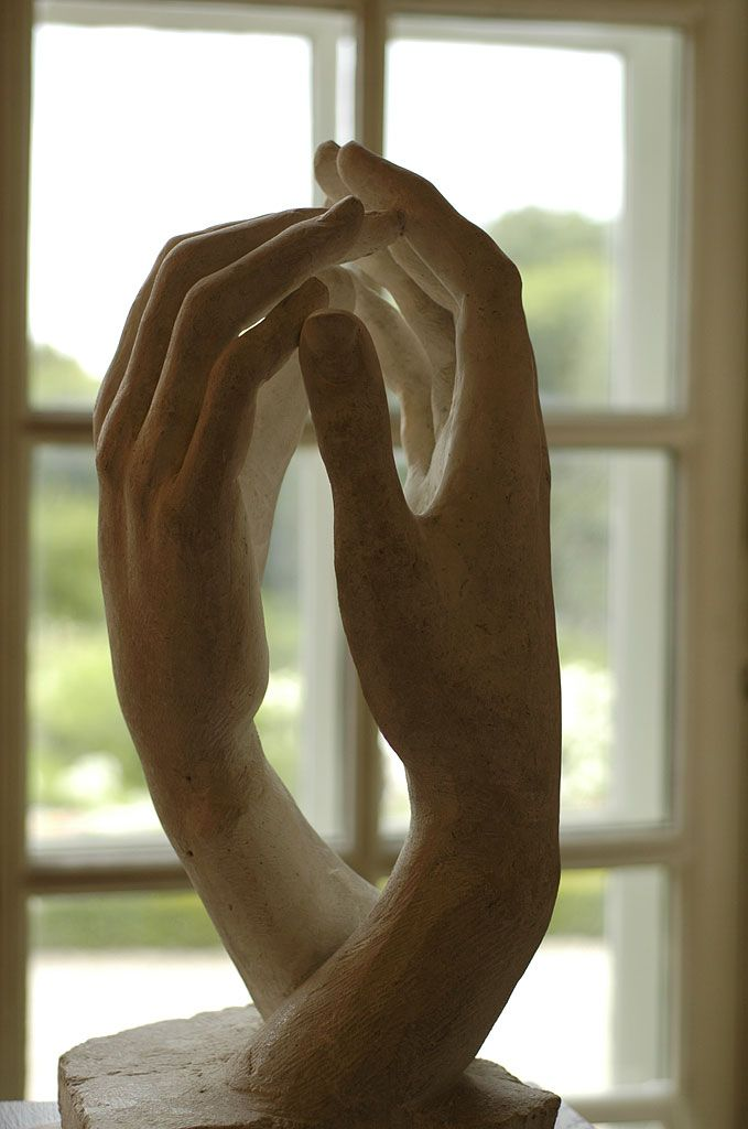 "Rodin's ""Cathedral"": when two hands in love leave sacred space, God will make that space His home. Look at the glow!"