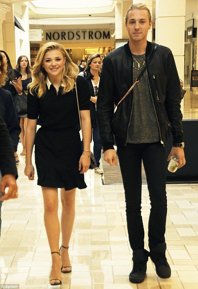 Chloë Grace Moretz wore a white collared black dress as she arrived at Tysons Corner Center Mall in McLean, Virginia (July 2014).