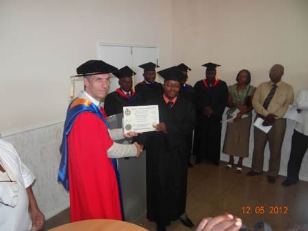 Prof. William Martin, BIU CEO, gives the degree to the graduate.