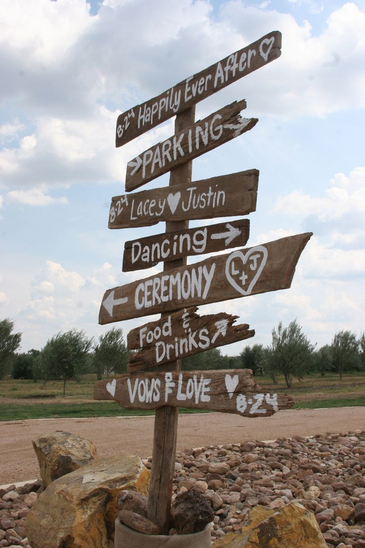 Cute Barn Wood Signs Pointing To The Outdoor Ceremony And Indoor Reception At Red Rock