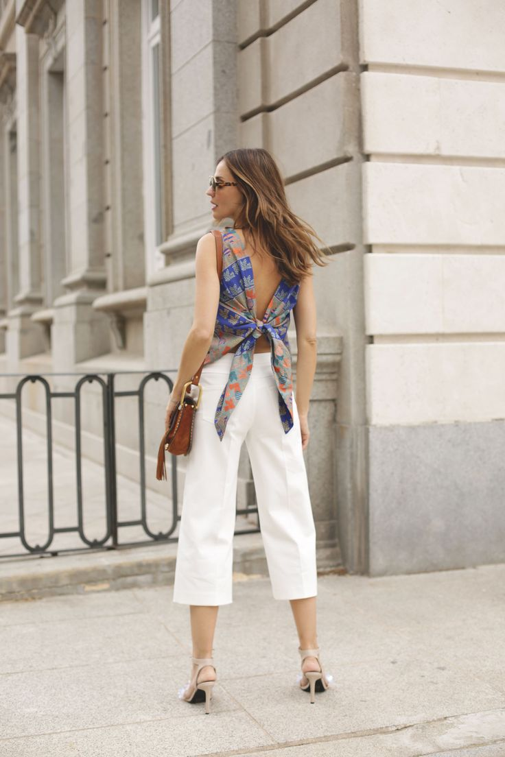 TRUCCO & AILANTO looks - Lady Addict. Blue floral back knot top+whie culotte pants+nude embellished lace-up sandals+brown studded crossbody bag+sunglasses. Spring Dressy Casual Outfit 2017
