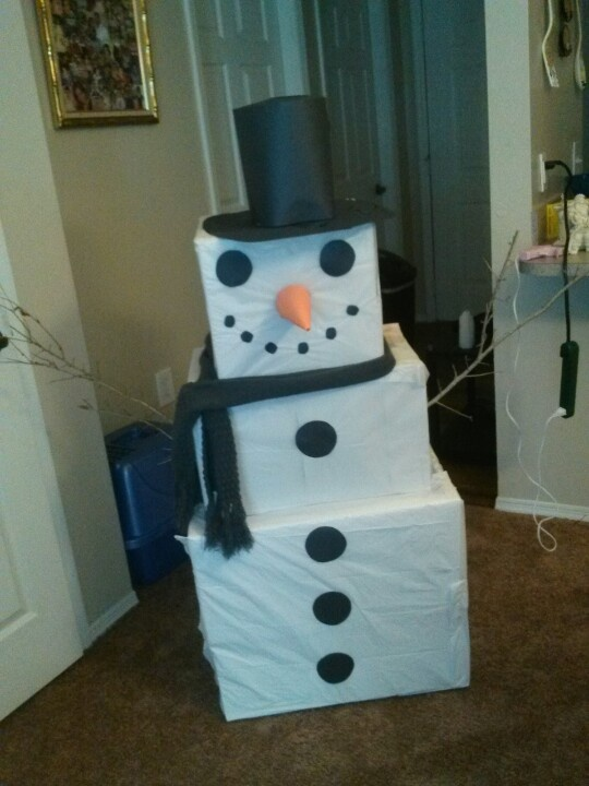 Snowman made of boxes and construction paper Cardboard