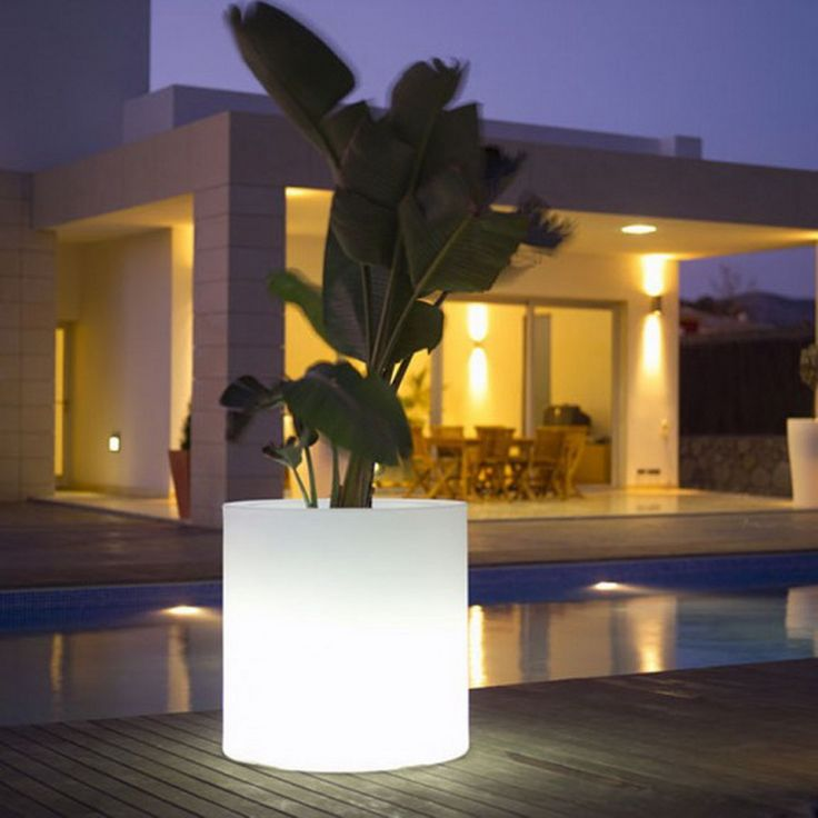 Illuminated Planters- great idea for outdoor lighting