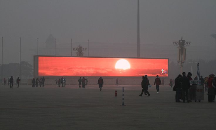 Beijing residents watch sunrise on giant commercial screens. The smog has become so thick in Beijing that the city's natural light-starved masses have begun flocking to huge digital commercial television screens across the city to observe virtual sunrises. The screens installed usually advertize tourist destinations.