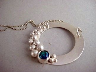 Necklace pendant with beautiful granulation and simple stone setting.
