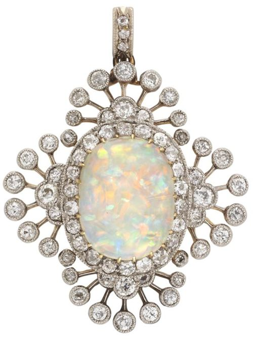 An Edwardian opal and diamond brooch, the oval cabochon-cut opal measuring approximately 14.3 x 11mm, yellow gold claw-set to the centre of an old-cut diamond cluster surround, all within a border of old-cut diamond sprays forming a quatrefoil design, all diamonds millegrain-set in silver to a yellow gold mount, with detachable brooch fitting and diamond-set pendant loop, gross weight 8.7 grams, circa 1900.