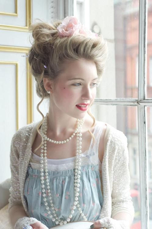 Lace and pearls and a sequined sweater with a classy up-do
