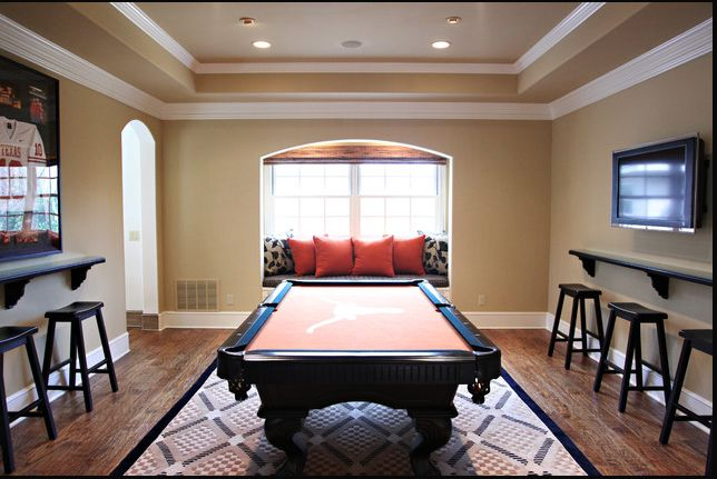 UT pool table? Game room decor. Like the small bar tables on either wall.