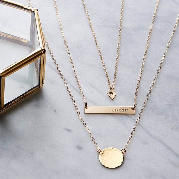 A horizontal 14k gold filled bar, diamond initial tag and hammered disc necklace set.
