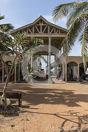 Square with shops and bars in a resort hotel in Serrekunda, Gambia. Entrance on…