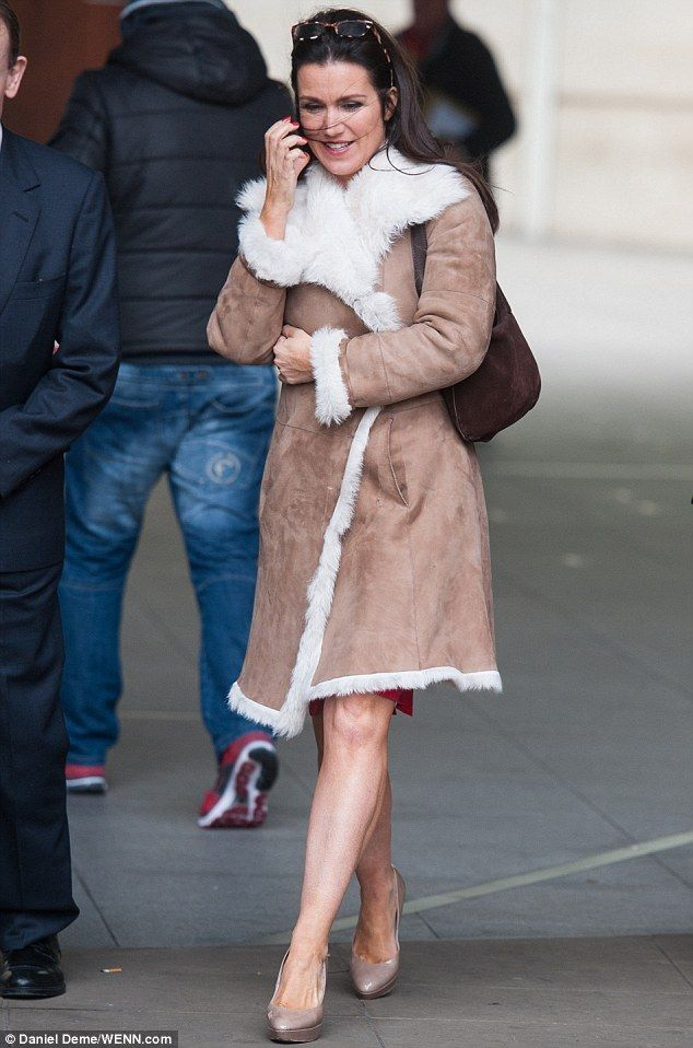 Specs appeal! The 44-year-old's sheepskin coat came complete with a thick, fluffy lining a...