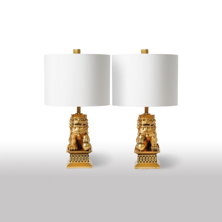Our Barbara Cosgrove Foo Dogs Mini Table Lamp Gold Leaf - Set of 2 lends the classic guardians of the Chinese Imperial City to the home or office. These lovely Asian-inspired fixtures stand guard with stylish versatility. A coordinating finial completes the eclectic look.