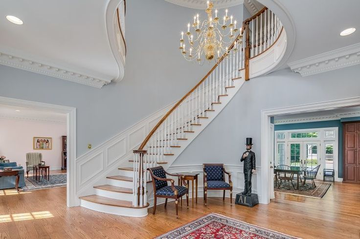 Traditional Staircase with Carpet, High ceiling, Wainscoting, Chandelier, Crown molding, Hardwood floors