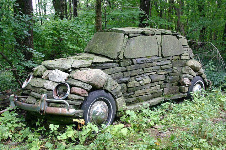 stone car with old car parts - pefect for the little patch of woods behind the house - make it hidden so it is something you stumble upon!  LOVE
