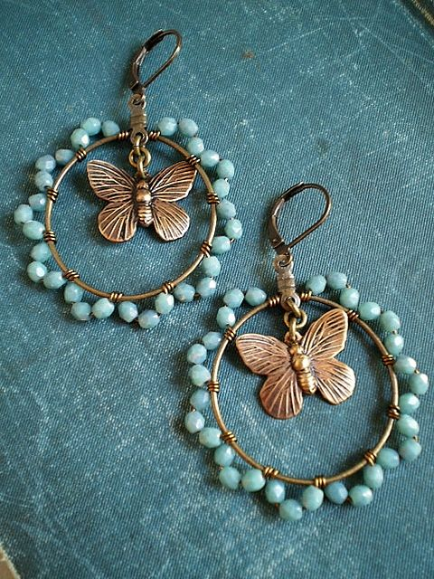 Feminine turquoise wire wrapped hoops with brass butterfly charms.Top to bottom these locking clasp earrings measure 2 1/4 inches/ approx 6 cm.Hoops alone measure about 1 1/4 inches/ 3 1/4 cm.Hoops ar..