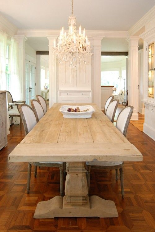 The perfect dining room: A little bit of rustic with a fabulous chandelier & white crisp accents. i have this table thank to my friend Thresia..