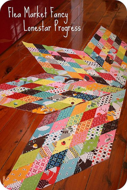 Pick up paint samples or mismatched paint for little money and try this on floor cloth for in front of the kitchen sink?