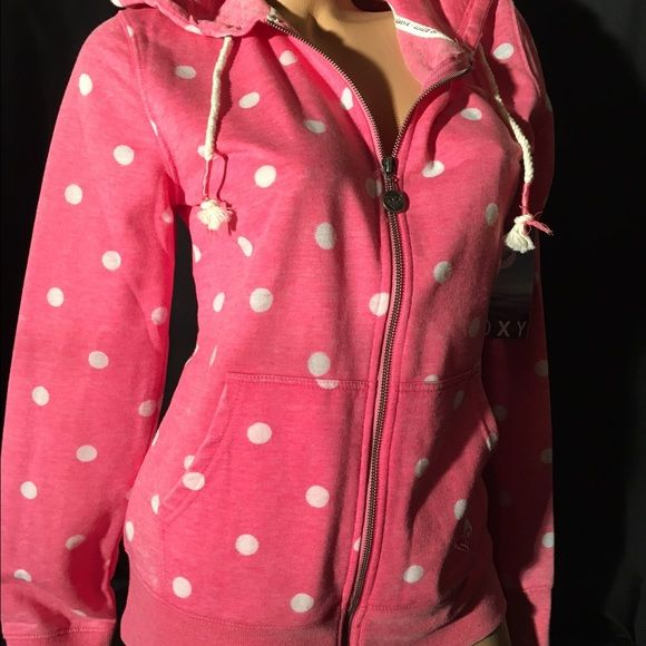 Roxy Hoodie Pink Polka Dot Who doesn't love polka dots? PINK polka dots!! This Roxy hoodie is crazy cute pink with white polka dots. Rope style hood drawstring with pink accents is that extra touch on this  hoodie you will love. It's comfy casual and perfect for any lazy Saturday or any day you just want to relax in style. Adorable and perfect for ladies of all ages!!                                                                 Sorry no trades Roxy Tops Sweatshirts & Hoodies