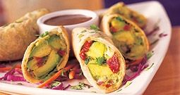 """Avocado Egg Rolls from BJ's Brewhouse. """"Crispy golden wontons wrap a tantalizing blend of avocados, cream cheese, sun-dried tomatoes, red onions, cilantro, pine nuts, chipotle peppers and spices. Served with a sweet tamarind sauce.""""  Deee-lish."""