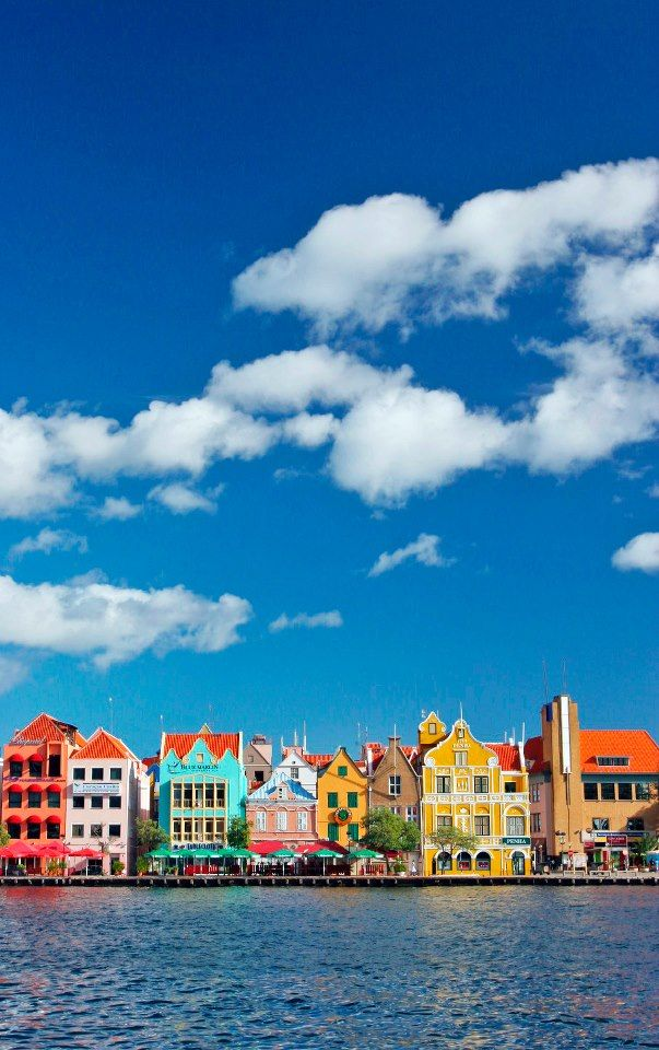 Willemstad, Curaçao. Discover the Dutch heritage of this colorful capital as you stroll past markets, mansions, and the Queen Emma pontoon bridge.
