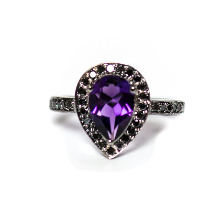 Quantity Available - 3  Amethyst pear and black diamond halo black gold alternative engagement ringThis is a deep purple pear cut amethyst with black diamonds around it and on the ring band. The ring is solid 14k gold plated with black gold.This ring will be custom made for you within 3-4 weeks.Ring specifications:• Choose your size from the drop down menu.• Amethyst pear cut approximately 1.80 carats. • Solid 14k white gold band plated with black gold.• Approximately 38 melee black diamonds…