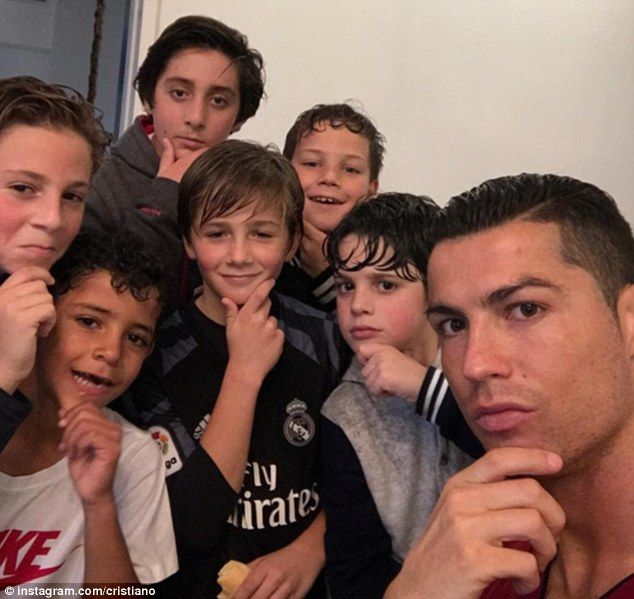 Cristiano Ronaldo's son (second from left) made fun of his father following his celebration