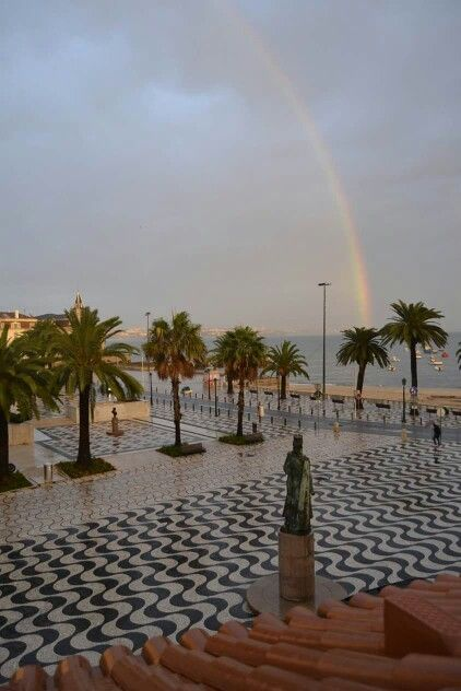 Cascais - follow the rainbow... beautiful the cobblestone sidewalks. Portugal