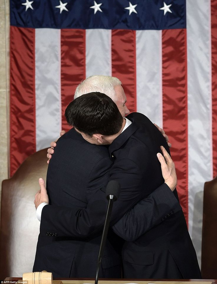 Brothers in arms: Mike Pence and Paul Ryan hug as they get read for the arrival of the pre...
