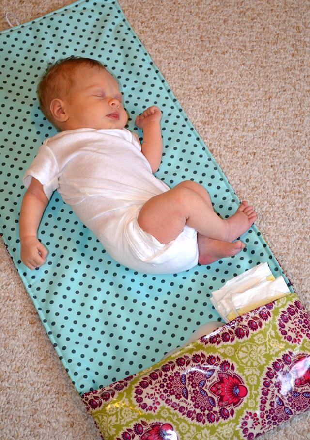 DIY your own wipe-able and washable changing pad, with diaper pockets. Casual Crafter