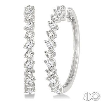 These earrings are a unique take on classic diamond hoops alternating round cut diamonds and emerald cut diamonds!