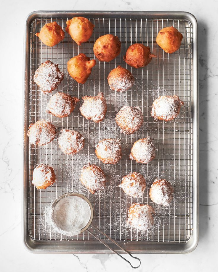 Apple-Studded Fritters | Martha Stewart Living - We love that you get tender, vanilla-scented apples with every bite of these golden doughnuts. Don't skimp on the powdered sugar!