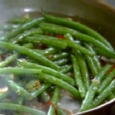 There is nothing as good as green beans cooked with bacon and brown sugar. True white trash cooks use canned beans.  Frozen green beans work fine, thaw them well; white trash 'chefs' may clean and par-cook fresh green beans. I use molasses as well, cook them til the butter mix is a little caramely. This is just fab with a nice fried chicken and corn bread. Rating: ***** paper plates