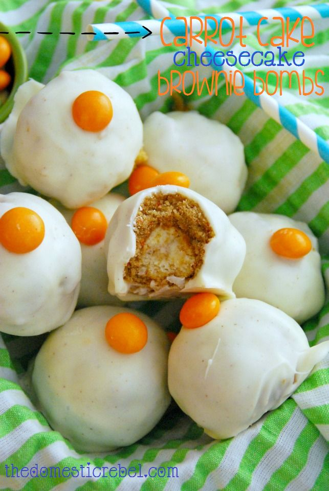 """Carrot Cake Cheesecake Brownie Bombs!  These are for all the carrot cake fans out there :) Creamy cheesecake center surrounded by a moist carrot cake """"brownie"""" and coated in a cinnamon white chocolate. #browniebombs #brownies #cheesecake #treats #carrotcake"""