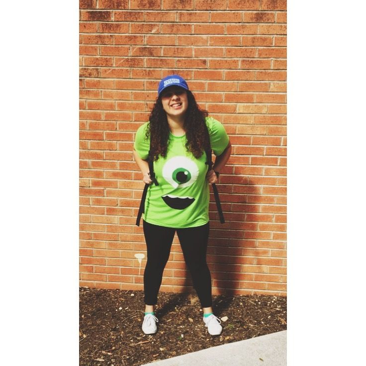Easy DIY Mike Wazowski costume. Face is painted on the plain green shirt. Hat was purchased at DisneyWorld.