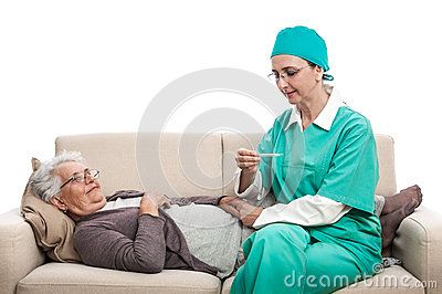 Temperature check. Medic or nurse with an old sick women at home. Carer checking fever. Isolated on white background.