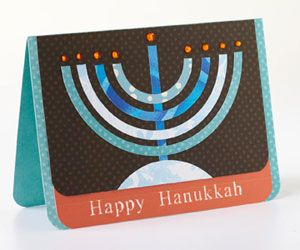 Using a circle cutter, create circle outlines in four sizes. Cut each circle in half to form a menorah.