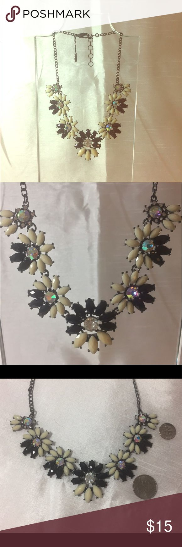Amrita Singh Cream/Black Necklace Amrita Singh Cream/Black costume necklace with faux diamonds. Four clasp options to modify length of necklace according to outfit. Worn once for an event. EUC. Amrita Singh Jewelry Necklaces