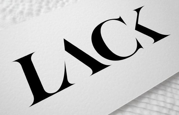 LACK Hungarian fashion magazine -  masthead by designer Bela Frank - the meaning of the word LACK, the lack of things... is reflected in the type with parts of the strokes missing... clever and memorable